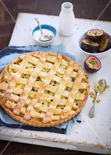 Apple and passion fruit tart with a lattice top