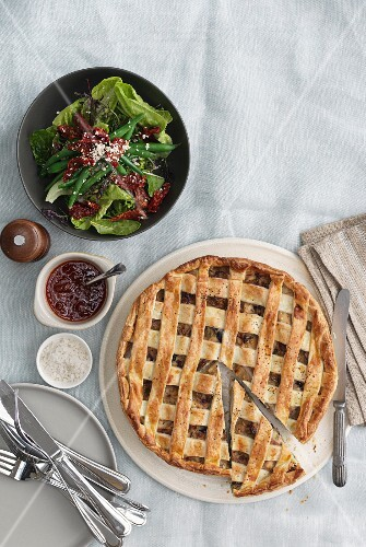 A lattice topped pie and a side salad