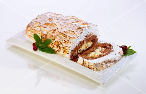 A Christmas Yule log cake with a meringue topping
