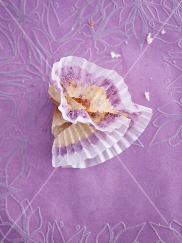 A scrunched paper case on a purple tablecloth
