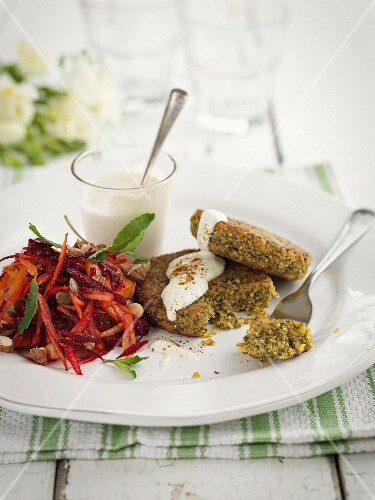Falafel with vegetables salad and yoghurt sauce