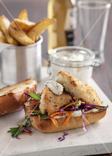 Fish burgers with sauce tartare and potato wedges