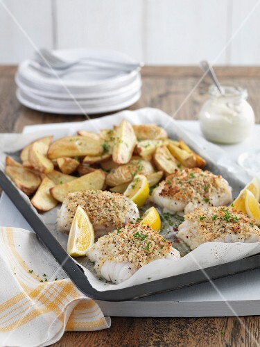 Baked fish fillets with a crust and potato wedges