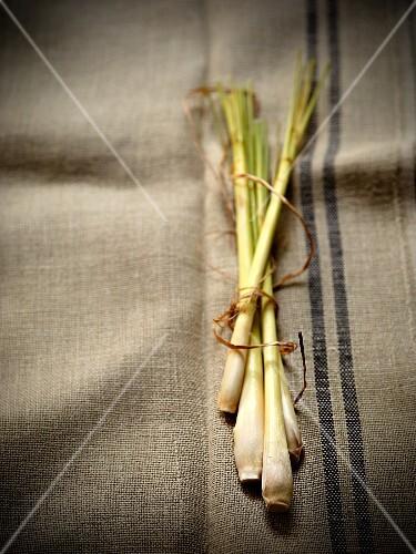 Fresh lemongrass on a linen cloth