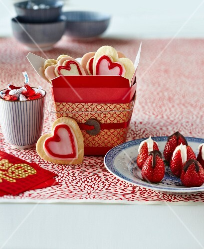 Heart-shaped biscuits, chocolate strawberries and pralines for Valentine's Day