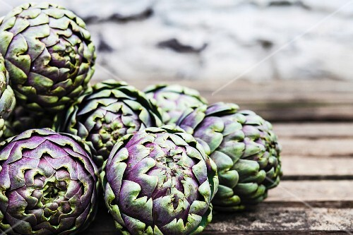 Artichokes on a wooden table