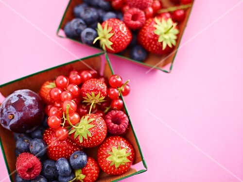 Fresh summer berries and fruits in small dishes