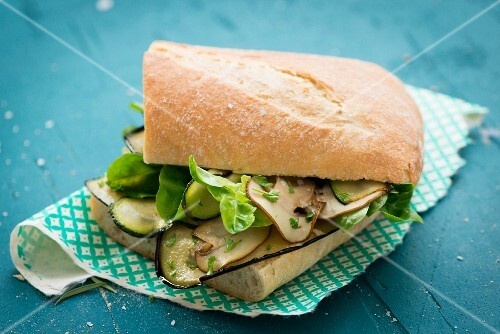 Ciabatta sandwich with roasted vegetables, mushrooms and lettuce