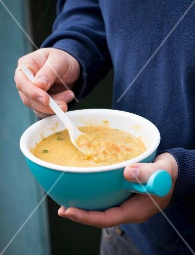 A man eating lentil soup