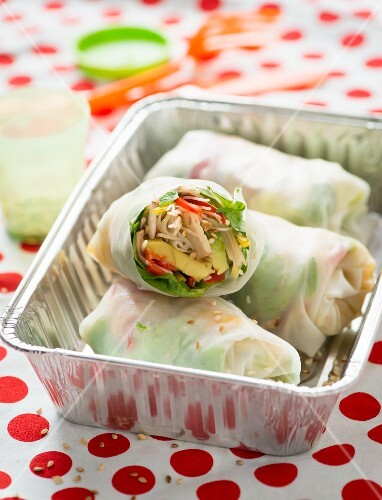 Summer rolls with avocado, chillis, lettuce, noodles and bean sprouts