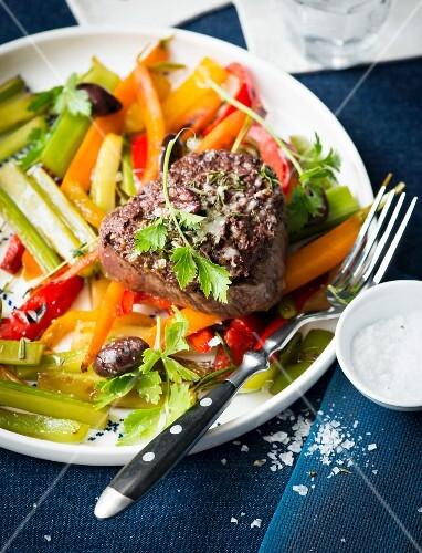 Fillet steak on a bed of vegetables