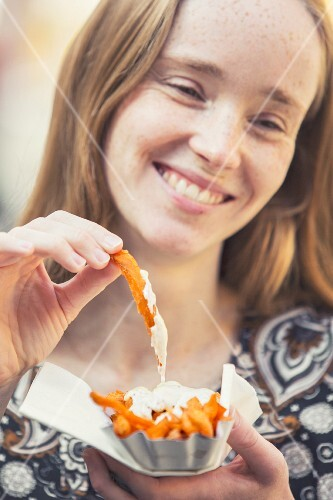 A young woman with sweet potato fries
