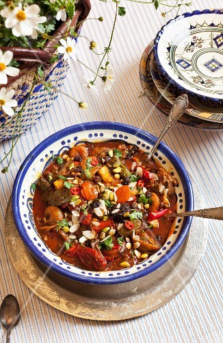 Braised beef tagine with raisins, figs, okra, peppers, ground pepper, coriander, pistachios and almonds (Morocco)