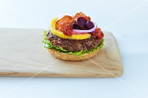 A hamburger with pineapple and bacon