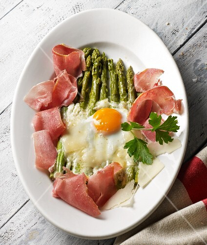 Green asparagus topped with melted Parmesan served with Parma ham and a fried egg