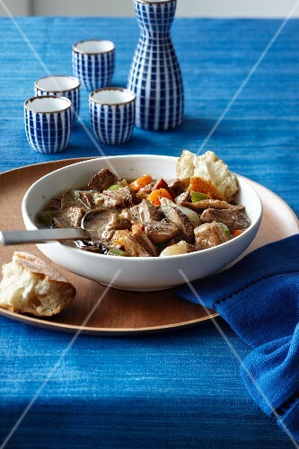 Beef stew with carrots, celery, onions and mushrooms