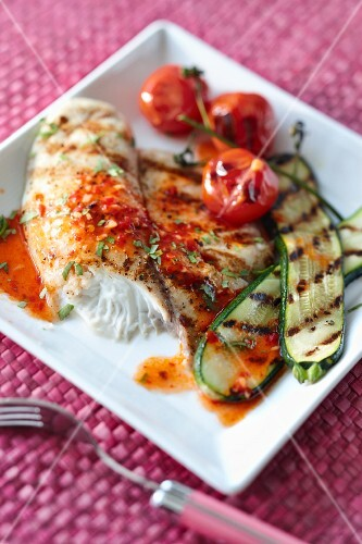 Grilled fish with a chilli and lime sauce and grilled vegetables