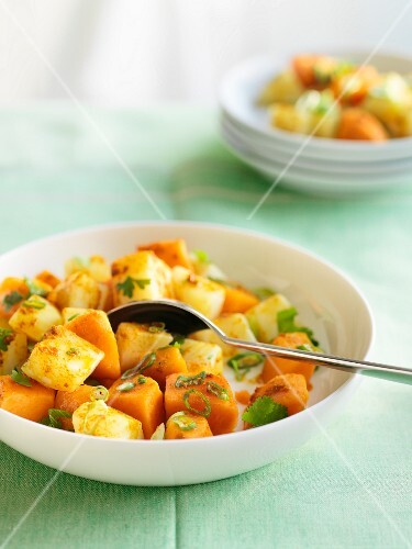 Potato and sweet potato salad with curry and coriander