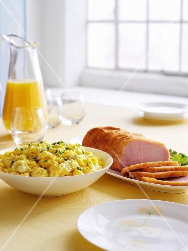 Easter brunch with scrambled egg, gammon and fresh orange juice
