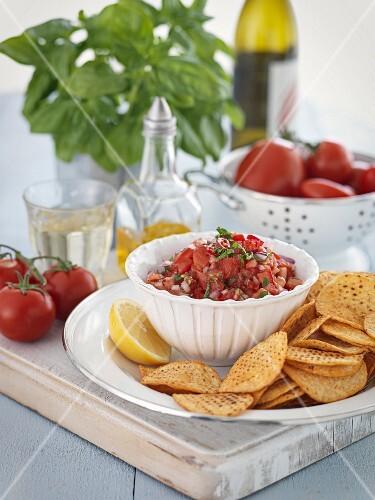 Tomato salsa with corn crisps