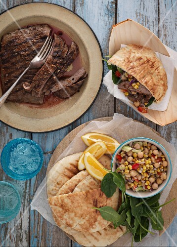 Grilled steak, pita bread and a chickpea salad