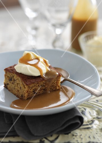 Date cake with caramel sauce and cream