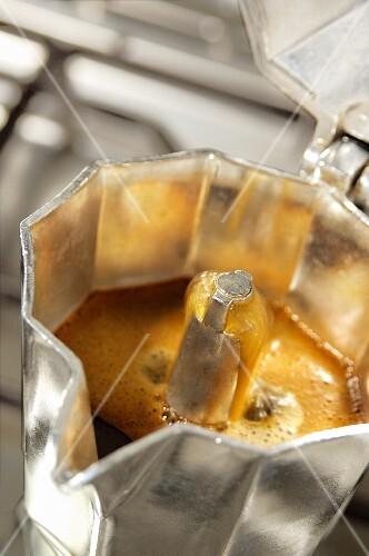 Coffee boiling in an espresso jug