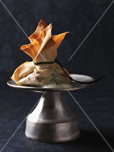 Fresh chanterelle mushrooms in a yufka pastry parcel with a herb and white wine sauce