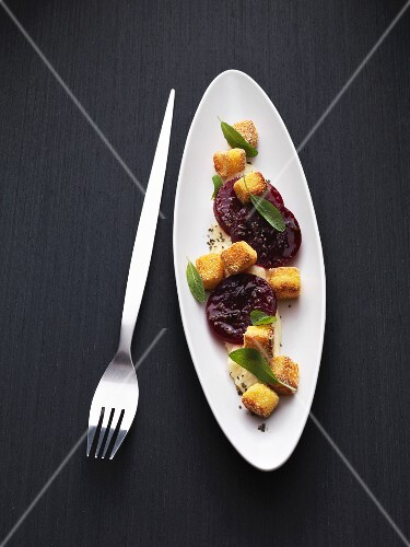 Braised beetroot with fried, diced polenta and sage
