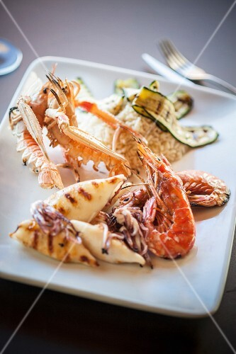 A grill platter featuring squid, prawns and langoustines