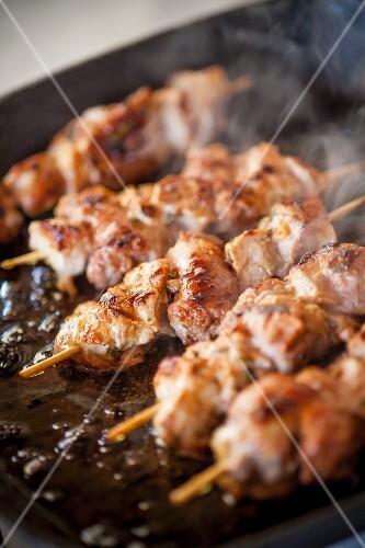 Veal kebabs being fried