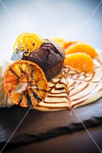 Chocolate orange cake on orange cream with whipped cream