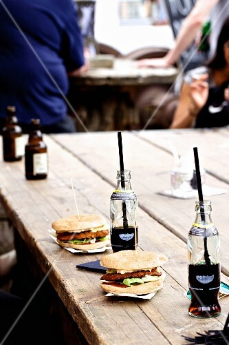 Burgers with cola on a wooden table