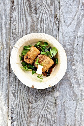 Fried pork belly with aubergine and coriander (Asia)
