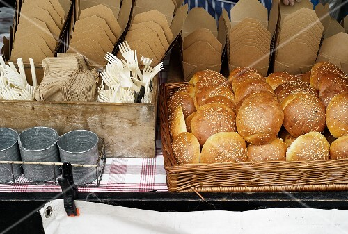 Sesame seed rolls, cardboard boxes and cutlery in a street kitchen (Covent Garden, London)
