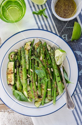 Grilled asparagus and courgettes with pine nuts and mustard dressing