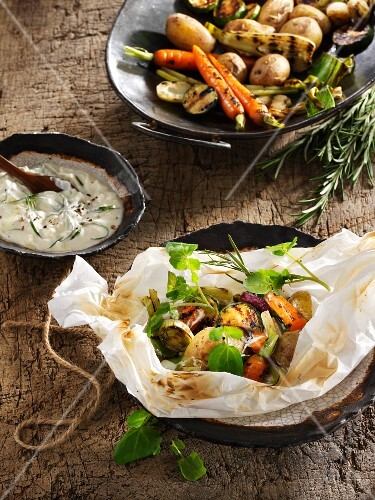 Spring vegetables with bellini potatoes in parchment paper