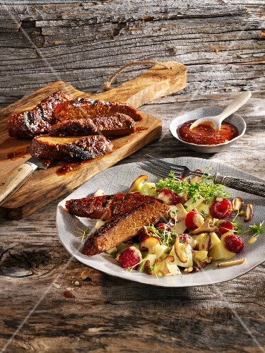 Grilled vegetarian ribs with barbecue sauce and a kohlrabi salad