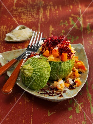 Hokkaido pumpkin risotto and beetroot served in a rondini squash