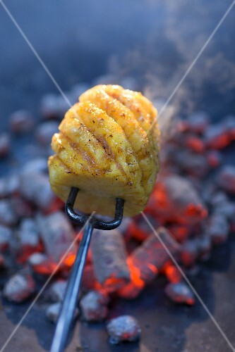 Grilled pineapple on a fork