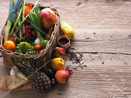 A basket of fresh fruit and vegetables with cheese and rice