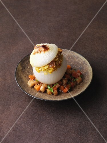 A white onion filled with vegetarian quinoa