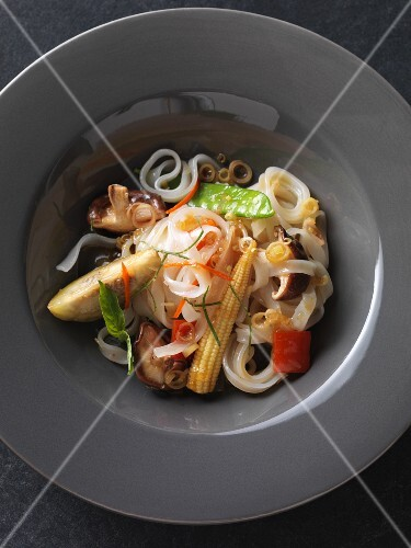 Vegan rice noodles with fried, oriental vegetables