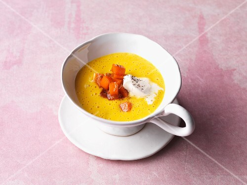 Sweet pumpkin soup with whipped cream