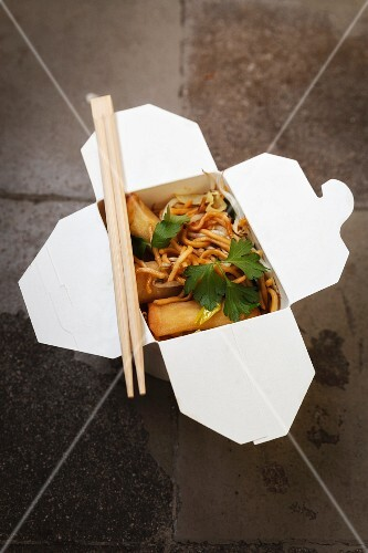 A box of fried noodles and spring rolls
