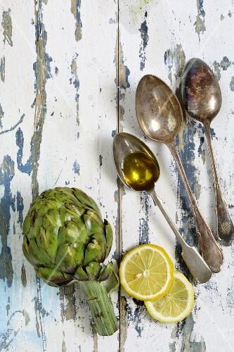Artichokes, lemon slices and olive oil