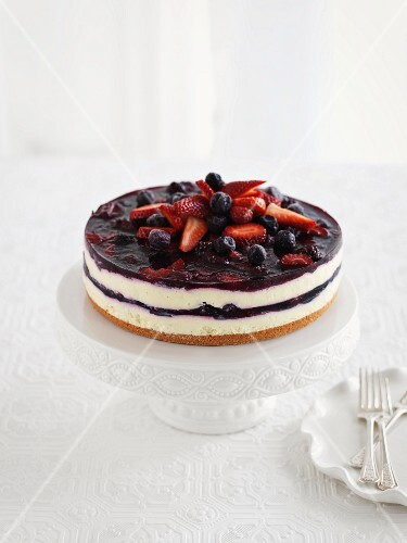 Cheesecake with berries on a cake stand
