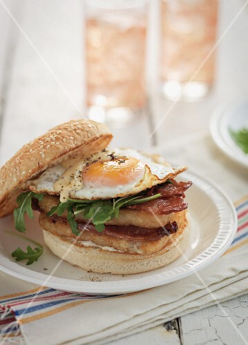 A burger with bacon and a fried egg