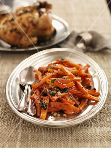 Glazed carrots with sage with roast chicken