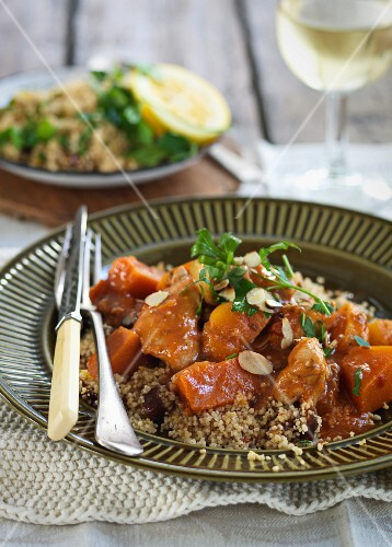 Chicken with apricots, flaked almonds and couscous
